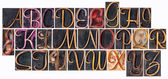 Alphabet in ornamental wood type — Stock Photo