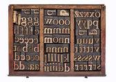 Wood type in typesetter box — Stock Photo