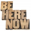 Stock Photo: Be here now reminder
