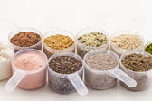 Scoops of seeds and powders — Stock Photo