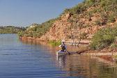 Canoe paddler on a mountain lake — Stock Photo