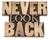 Never look back in wood type — Stock Photo
