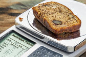 Banana bread on diet scale — Stock Photo