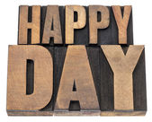Happy day in wood type — Stock Photo