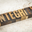 Integrity word in wood type — Stock Photo