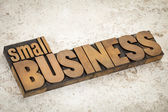 Small business in wood type — Stock Photo