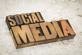 Social media text in wood type — Stock Photo