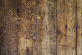 Vandal graffiti on wood wall — Stock Photo