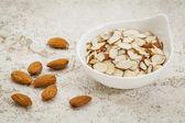 Sliced raw almonds — Stock Photo