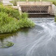 Stock Photo: Cleaned sewage flowing