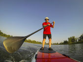 SUP - stand up paddling — Stock Photo