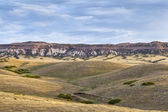 Rolling prairie and cliff — Stock Photo