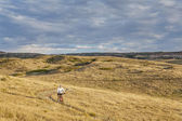 Moutain biking in a rolling prairie — Stock Photo