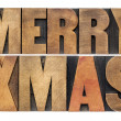 Merry Xmas in wood type — Stock Photo