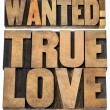 Wanted true love in wood type — Stock Photo