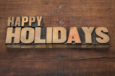 Happy holidays in wood type — Stock Photo