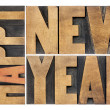 Happy new year in wood type — Stock Photo