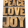 Peace, love and joy in wood type — Stock Photo