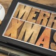 Stock Photo: Merry Xmas on digital tablet