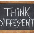 Think different on blackboard — Stock Photo