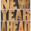 Stock Photo: New year ahead in wood type