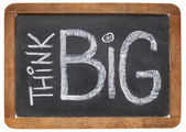 Think big on blackboard — Stock Photo
