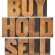 Buy, hold, sell in wood type — Stock Photo