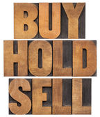 Buy, hold, sell in wood type — Stockfoto