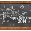 Happy New Year 2014 on blackboard — Stock Photo