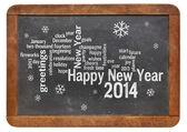 Happy New Year 2014 on blackboard — Stock Photo