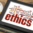 Ethics word cloud on digital tablet — Stock Photo