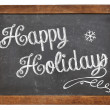 Happy Holidays on blackboard — Stockfoto