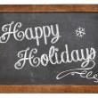 Happy Holidays on blackboard — Stock Photo