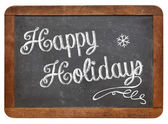 Happy Holidays on blackboard — Stock Photo