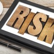 Stock Photo: Risk - word on digital tablet