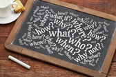 Brainstorming questions on blackboard — Stock Photo