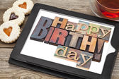 Happy birthday on digital tablet — Stock Photo
