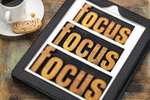Focus concept on digital tablet — Stock Photo