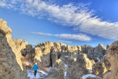 Hiker in Natural Fort rock formation — Stock Photo