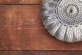 Metal steamer basket — Stock Photo