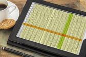Data spreadsheet on digital tablet — Stock Photo