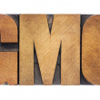 Stock Photo: GMO acronym in wood type