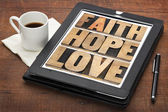 Faith, hope and love on digital tablet — Stock Photo