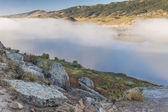 Mountain lake in a fog — Stock Photo