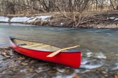 Red canoe on a river — Stock Photo