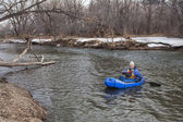 Paddling a packraft on a river — Stockfoto