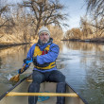 Постер, плакат: Canoe paddling on Poudre River