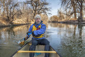 Canoe paddling on Poudre River — Stock Photo