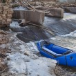 Stock Photo: Packraft and river dam