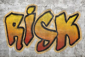 Risk word graffiti on plaster wall — Stock Photo
